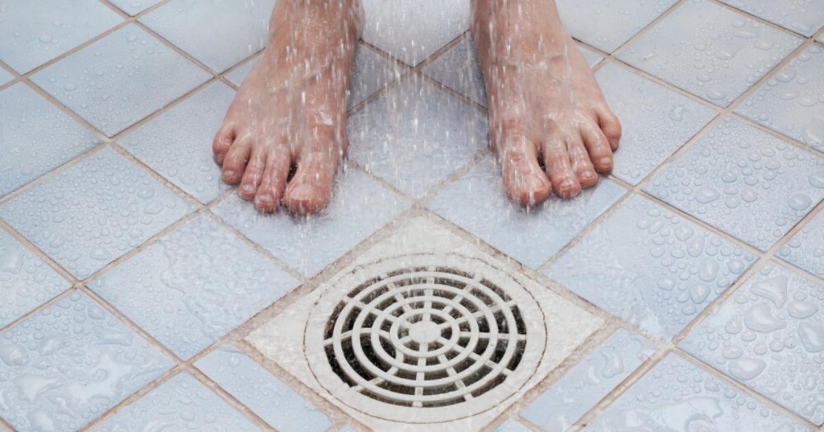 Athletes foot causes barefoot man in locker room shower