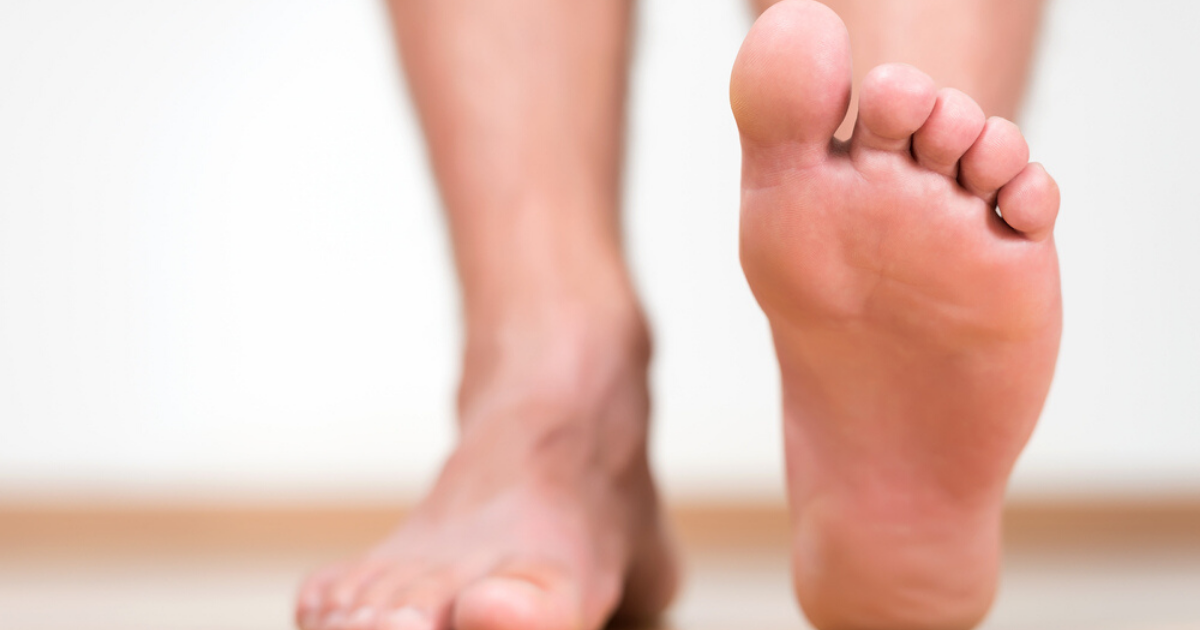 Foot lifted off the floor of person who successfully finished athletes foot treatment by being consistent