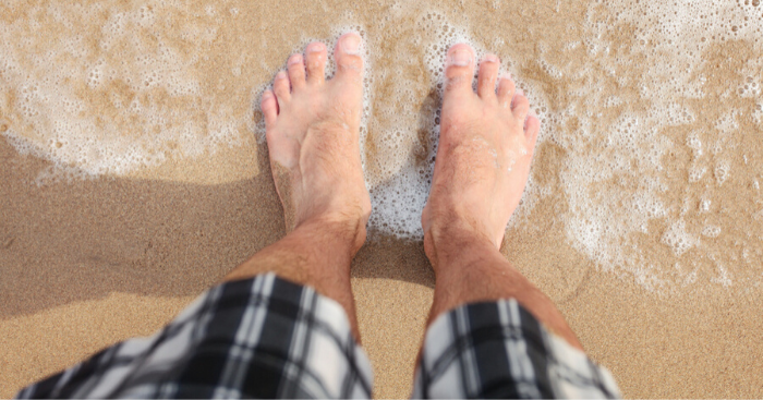 cured athletes foot with silka cream now has healthy feet on beach
