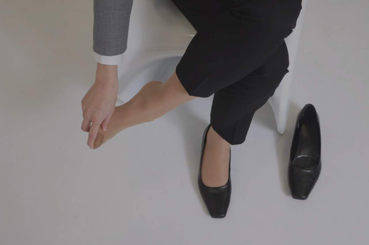woman with irritating athletes foot wondering how to incorporate athletes foot prevention tips into her office routine