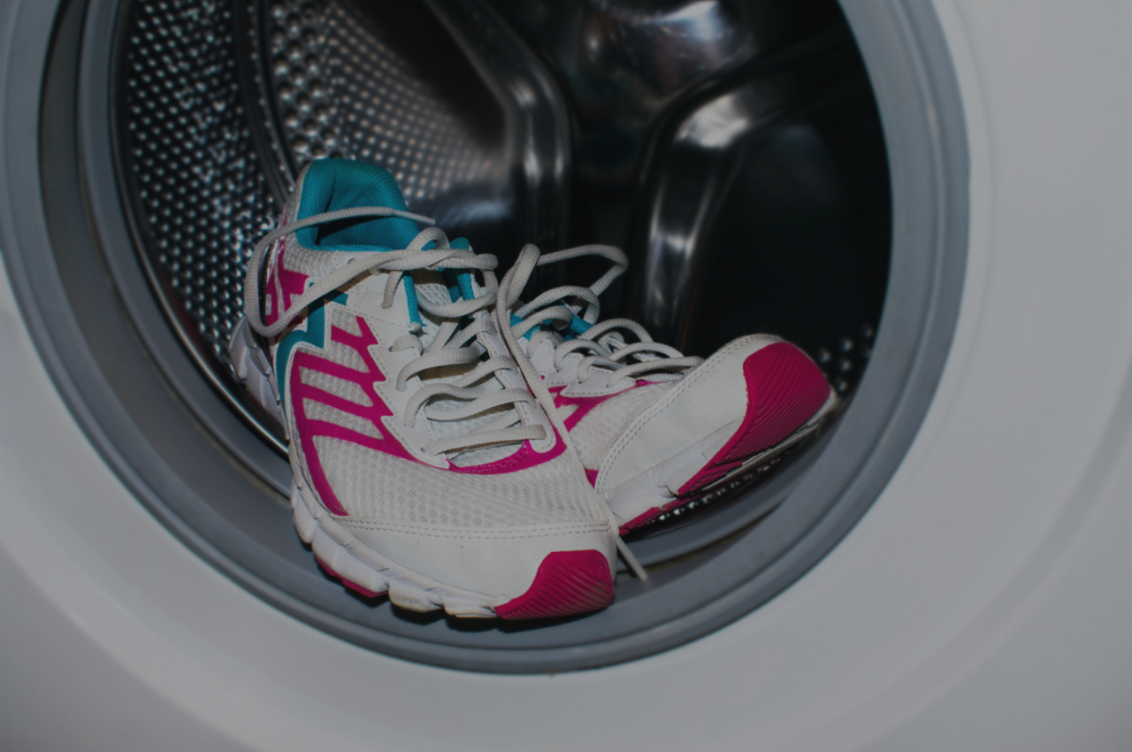Shoes being washing in a washing machine to prevent athlete's foot