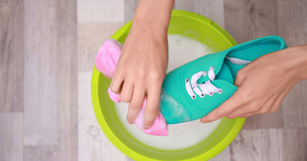 green shoes being washed by hand to prevent athletes foot