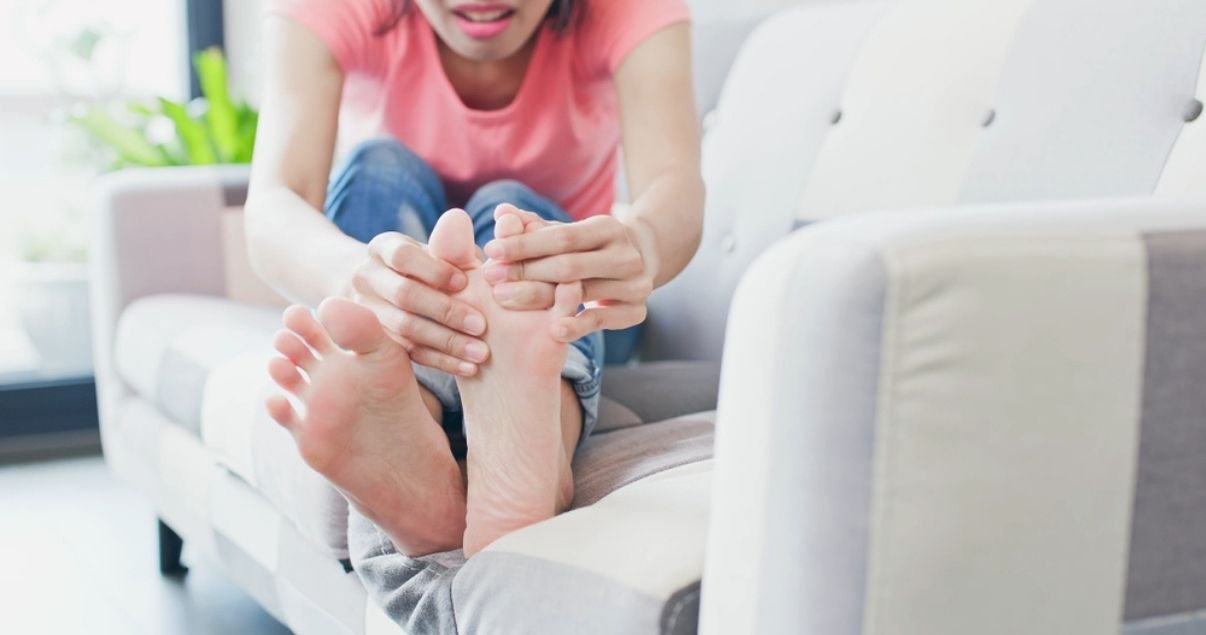 woman looking to incorporate better a foot care routine in order to keep athletes foot away