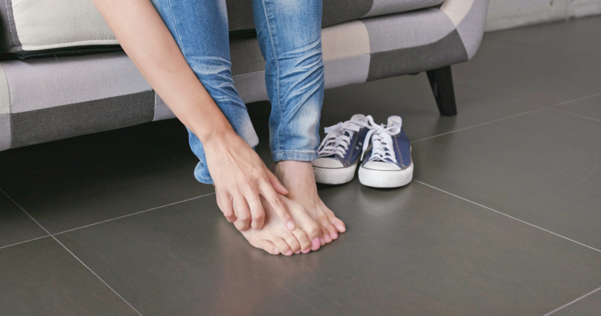 Woman with athletes foot wondering about athletes foot prevention