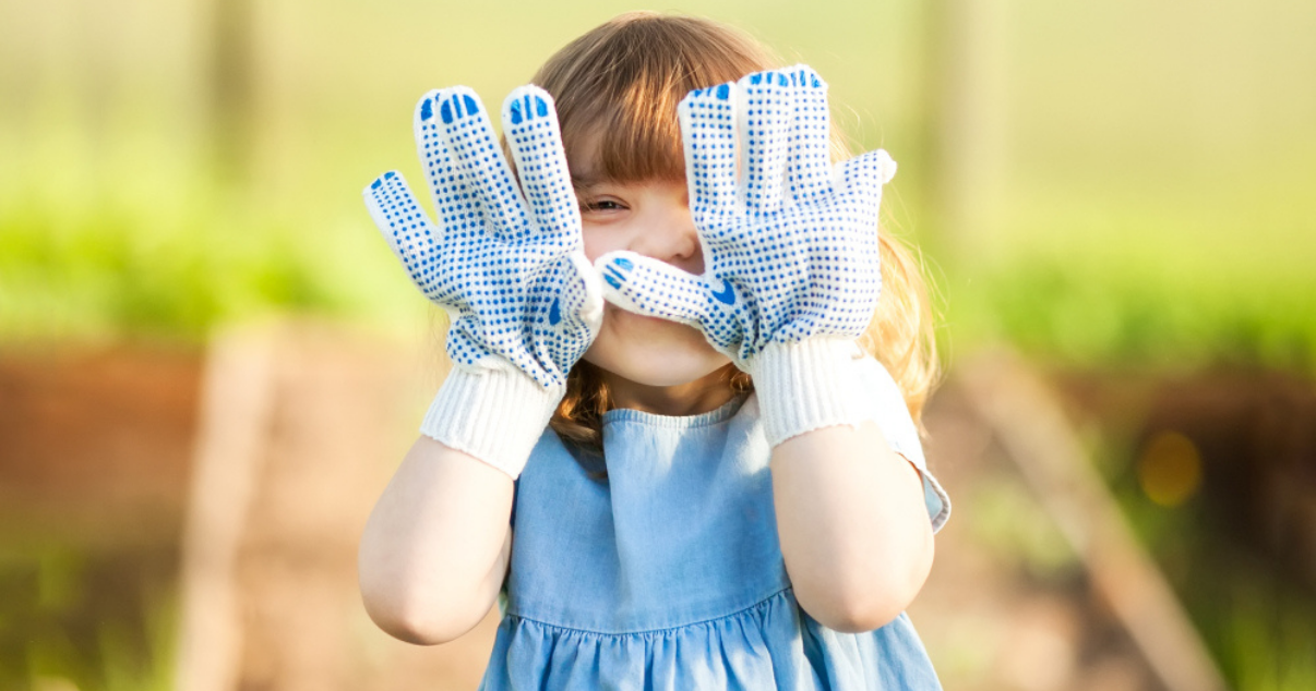 Girl using her gardening gloves outdoors preventing a ringworm infection