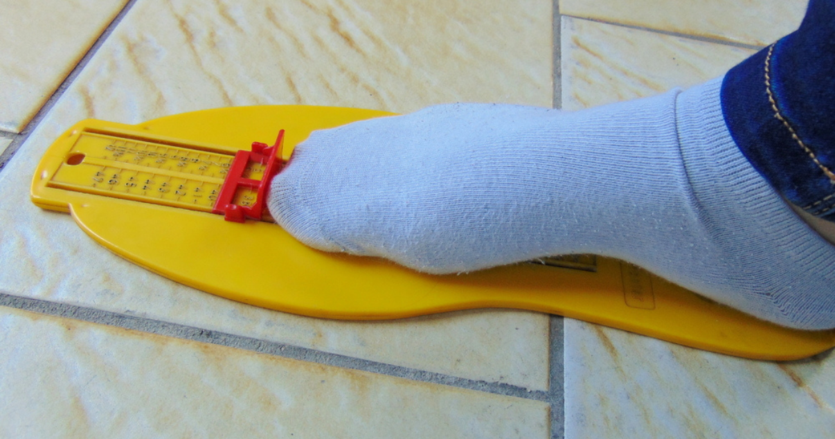 foot getting measured to prevent athletes foot