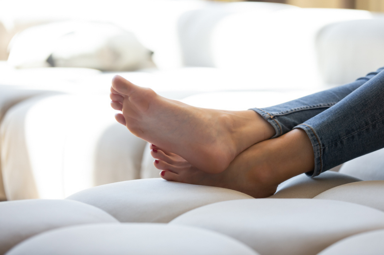 healthy feet on sofa without athletes foot symptoms